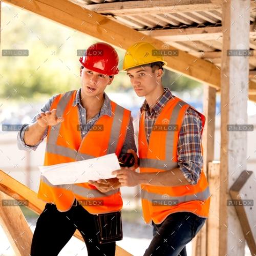 demo-attachment-136-op_two-men-dressed-in-shirts-orange-work-vests-and-KE9JMU2-scaled